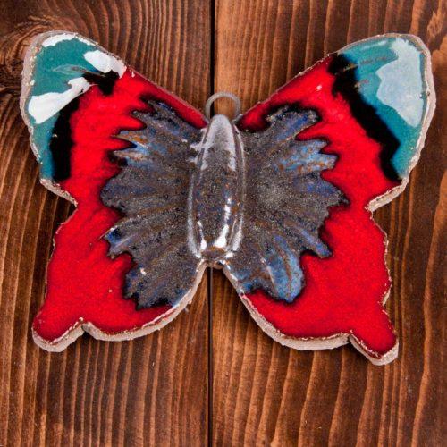 Ozdoba motyl ceramiczny różnokolorowy.